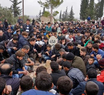 After killing, defiant Syria town determined to protest on