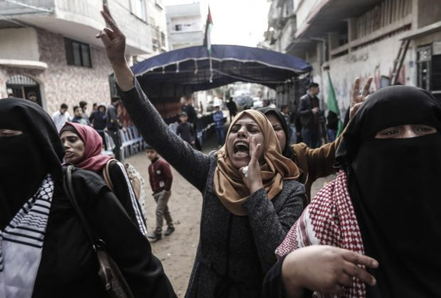 Palestinians mourn woman killed by Israeli fire at protest